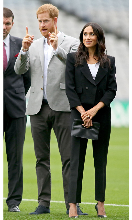 Meghan wore her fifth look in two days while watching traditional Gaelic sports being played at Croke Park on July 11. The duchess traded her chic grey Roland Mouret dress for a black Givenchy power suit, which she paired with a white round-neck t-shirt, a leather Givenchy handbag and black Sarah Flint pumps.