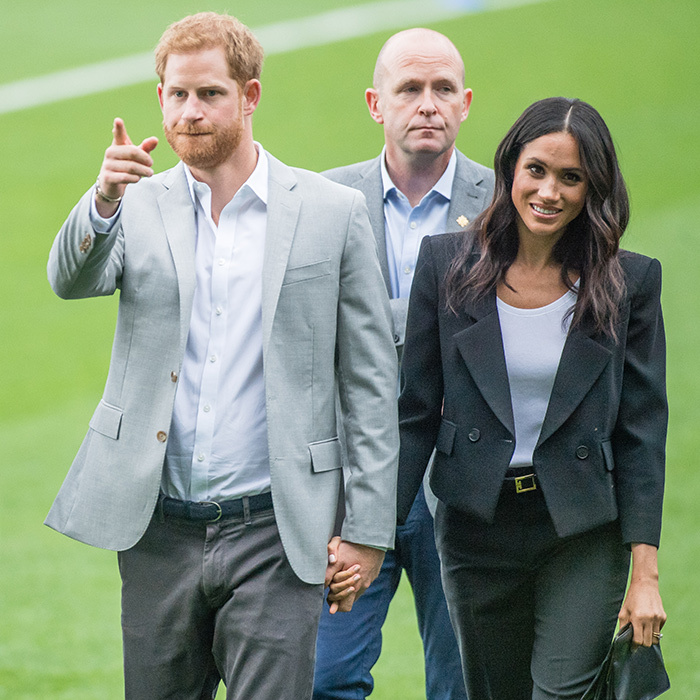 Meghan and Harry showed a little PDA while walking on the Croke Park field. 