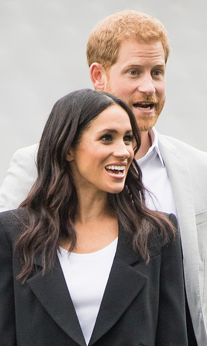Meghan and Harry had almost the exact same expression while watching the youth play!