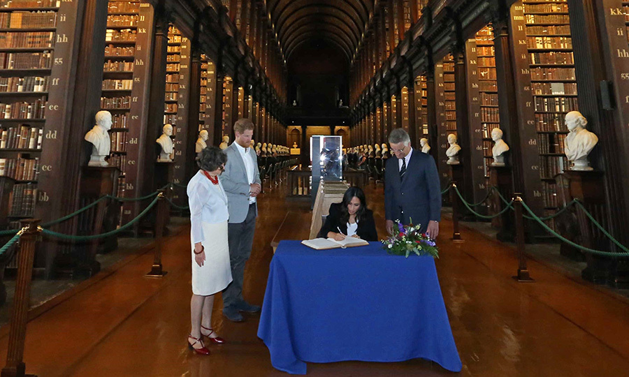 The Duchess of Sussex signed the visitor's book during a visit with Harry to Trinity College. The pair spent some time looking at the historic Book of Kells and also made a stop at The Long Room of the Old Library at Trinity College, which contains the oldest harp in Ireland. Built between 1712 and 1732, the iconic Long Room holds the collection's 200,000 oldest books.