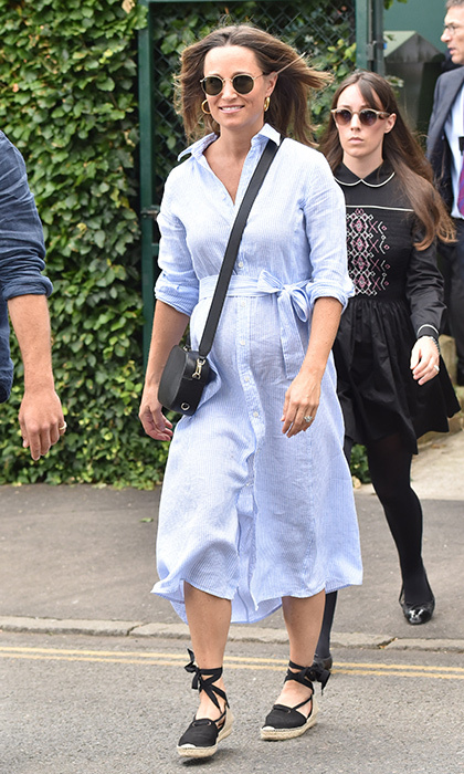 Mom-to-be Pippa Middleton was back at Wimbledon on July 11, looking cute and comfortable in a blue Ralph Lauren shirtdress with espadrilles and a cross-body bag. Kate's little sister was joined by their brother, James Middleton, both of whom were dressed to impress at their nephew Prince Louis' christening just a few days ago on July 9. Avid tennis fan Pippa has said that, like Serena Williams, she plans to play tennis well into her pregnancy. 