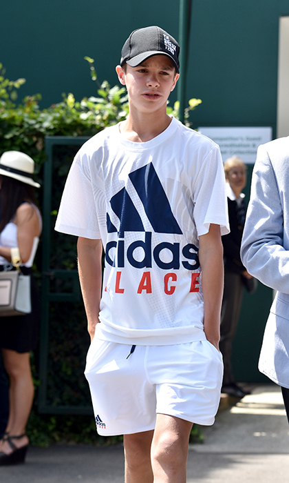 Romeo Beckham donned his tennis whites in an Adidas ensemble to take in the action on day nine of the tournament. The 15-year-old, who attended with his grandfather, is a budding tennis player himself.