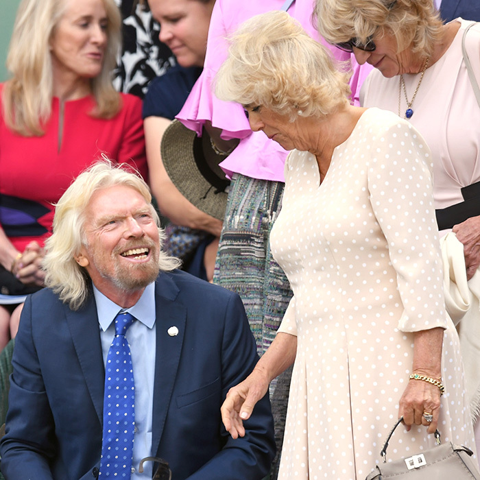 The Duchess of Cornwall chatted with Richard Branson in the royal box during her first Wimbledon stop of 2018 on July 11, which will see Roger Federer compete. Camilla donned a pretty polka-dot ensemble with nude pumps and a Fendi handbag.