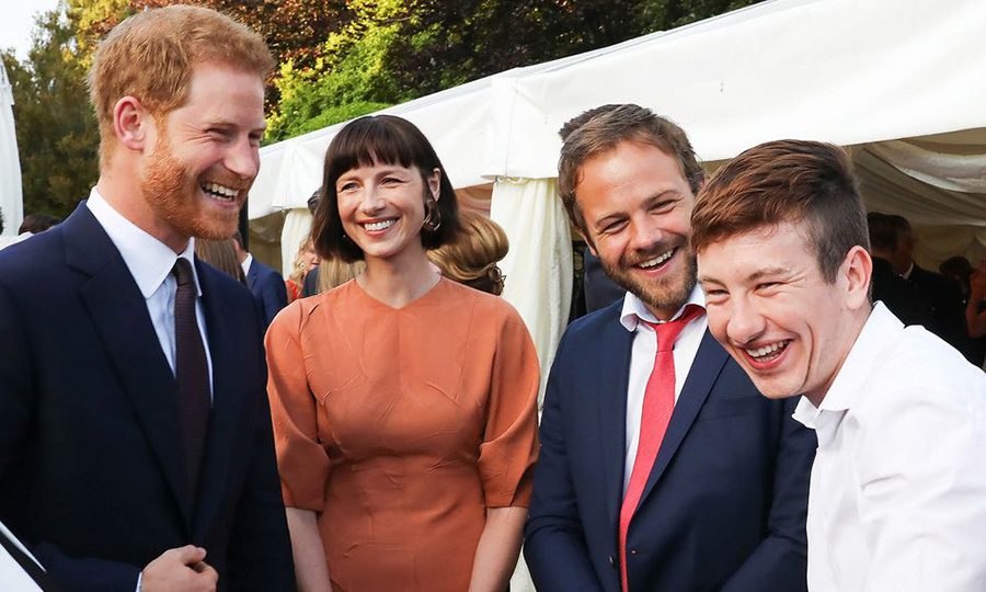 Prince Harry had a laugh with a group of Irish actors while attending a garden party at the British Embassy on July 11, 2018 during his two-day tour of Ireland. Though wife Meghan was nowhere to be seen, the royal had a ball chatting with <em>Outlander</em> star Catriona Balfe, <em>Vikings</em> actor Moe Dunford and Barry Keoghan, who recently starred in <em>The Killing of the Sacred Deer</em> opposite Nicole Kidman and Colin Farrell. 