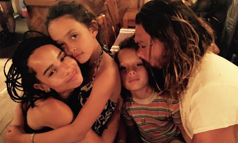 So cute! Jason laid a smooch on his son Nikoa-Wolf while his daughter hugged her half-sister, actress Zoe Kravitz. 
