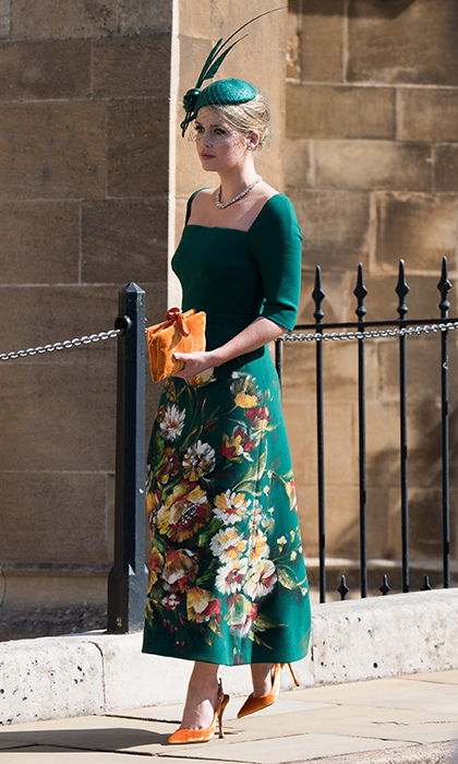 Lady Kitty Spencer turned heads on May 19, 2018 as she attended her cousin Prince Harry's royal wedding to Meghan Markle in Windsor. The emerald-green midi dress painted with flowers was by her go-to label, Dolce & Gabbana, and she paired the pretty piece with orange velvet pumps and purse, plus a matching netted fascinator.<p>Photo: © Getty Images