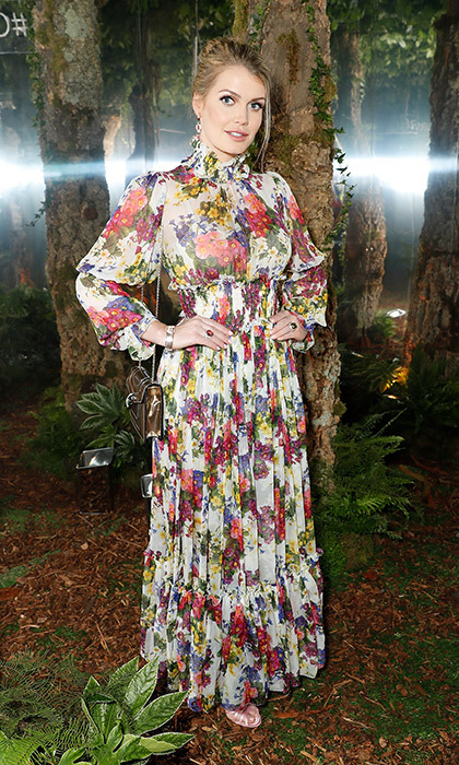 Mesmerizing in a pansy-printed gown by - who else? - Dolce & Gabbana, Lady Kitty hit the Sky Garden for the BVLGARI MAN WOOD ESSENCE event in London on July 10, 2018.