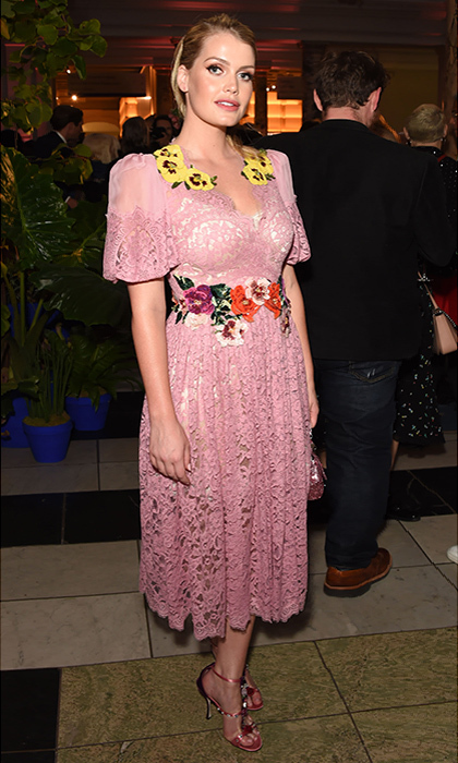 The model was pretty in pink wearing a Dolce & Gabbana lace dress with a touch of floral detail along her waist and neckline in London on June 13, 2018.  