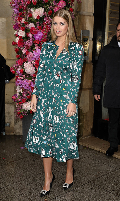 Another winning print in January 2018! Lady Kitty wore her green shirt dress with with sleek locks and embellished pumps at the Schiaparelli Spring/Summer 2018 Fashion Show in Paris on Jan. 22, 2018.