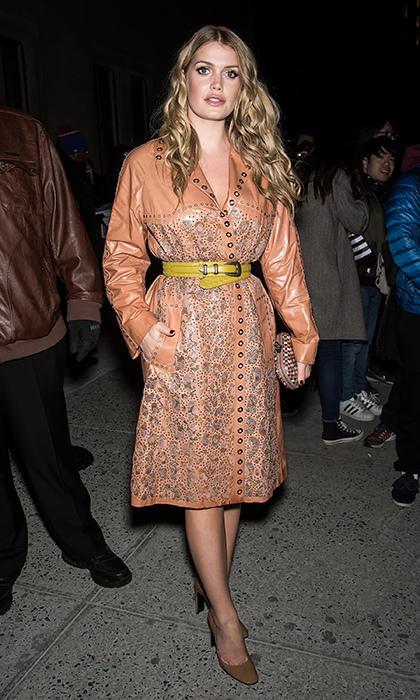 Looking chic as always in this tan studded leather coat by Bottega Veneta, which she paired with a yellow belt, Lady Kitty made the rounds at New York Fashion Week in February 2018.