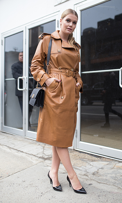 Lady Kitty donned a simple yet sophisticated brown leather trench coat  in February 2018 in New York, wearing her beautiful blonde hair pulled back in a sleek and low ponytail.