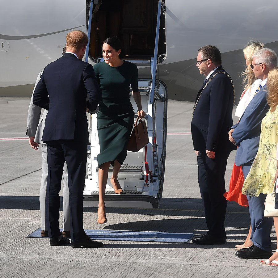Meghan also had a smooth exit from her first tour plane on July 10, 2018, two months after she wed Prince Harry - though the sixth-in-line to the throne and his wife were only on a quick two-day visit to Ireland. Unlike Kate's small clutch on arrival in Canada, Meghan carried a large Strathberry tote with her green Givenchy ensemble - which paid homage to the Emerald Isle - and pulled all of her hair back into a sleek bun. 