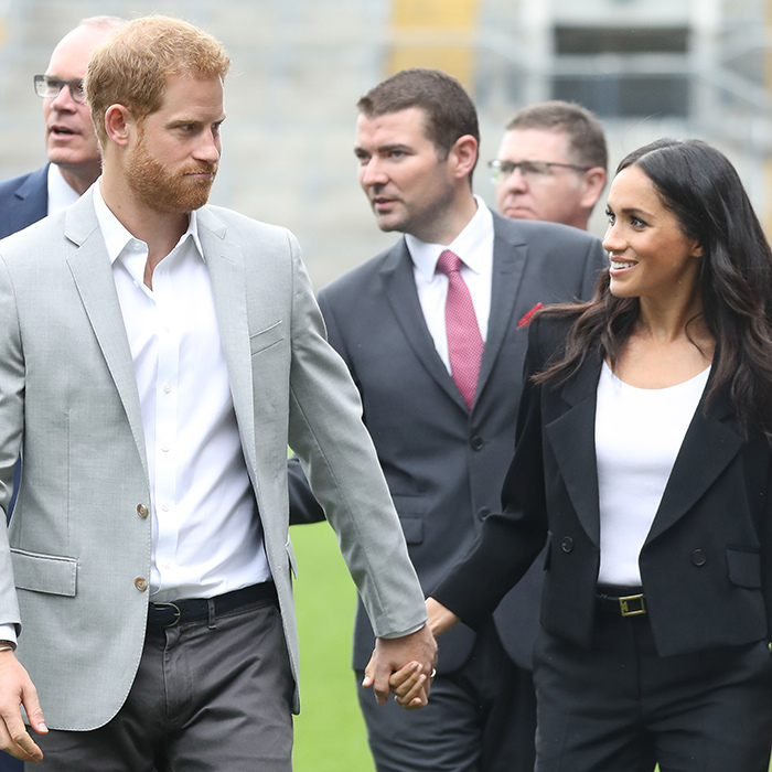 Meghan grinned as Prince Harry pulled a face in Croke Park, Dublin. The two clasped hands sweetly as they walked onto the field.