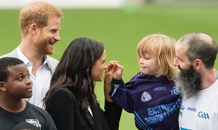 Easily one of the sweetest moments from Meghan and Harry's royal tour of Ireland, three-year-old Walter Cullen reached out to touch the duchess. But Harry's reaction was especially priceless! Just after this shot was taken, the prince pretended to scold the boy.