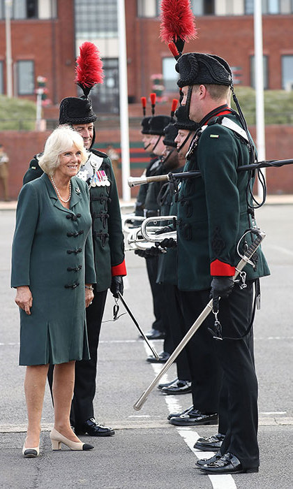 The Duchess of Cornwall put her best fashion foot forward on July 12 when she stepped out in Aldershot, Hampshire to attend the Medal Parade. Camilla showed off her chic sense of style in a beautiful green dress with chunky black buttons down the front, pairing the look with elegant cap toe shoes.