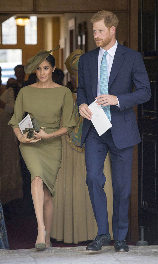 The proud aunt attended her new nephew Prince Louis' christening alongside hubby Prince Harry wearing a mix of American and British designers, plus suede pumps by Spaniard Manolo Blahnik. Her olive-green dress was by American label Ralph Lauren and featured a number of the favoured elements in her new royal uniform: a boat neck, a skinny belt and a figure-skimming silhouette. The royal accessorized the ensemble with a slanted hat by British milliner Stephen Jones, who also designed the white beret she wore on Commonwealth Day, and a matching bag and gloves. Fans have speculated whether the gloves may have been a nod to the Queen's tendency to cover her hands when greeting large groups of people to keep germs at bay.