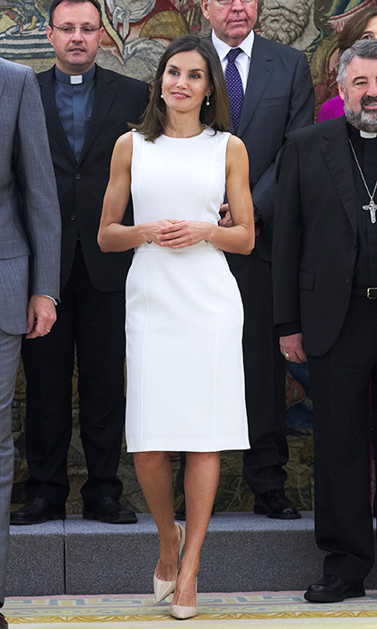 On July 10, the Queen of Spain looked summer ready in a white midi-dress and beige patent leather heels.