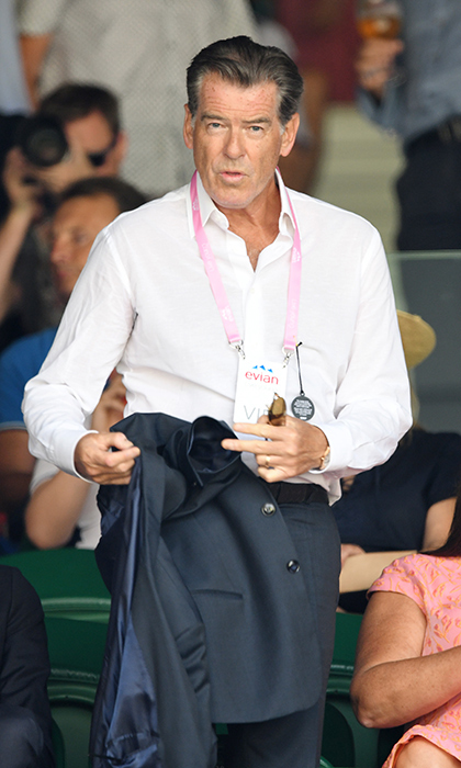 Pierce Brosnan looked dapper as ever on July 13 as he took his VIP seat between wife Keely Shaye Smith and his model son Dylan. The <em>Mamma Mia</em> star paired his navy suit with a crisp white shirt. 