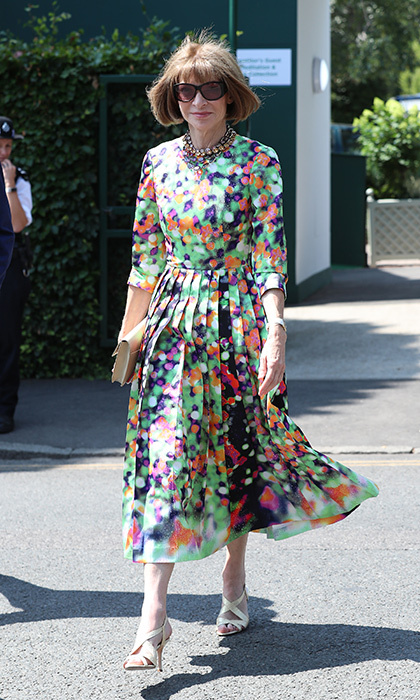 Vogue icon Anna Wintour wore a gorgeous abstract-printed dress with gold accessories and her signature oversized sunnies on the tenth day of the tennis tournament.