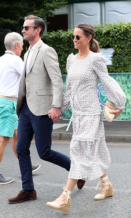 Pregnant Pippa Middleton was back at it alongside her husband James Matthews. Kate's sister stunned in a floral-printed Anna Mason maxi dress, which featured balloon sleeves and embellished shoulders, and finished her look with espadrilles and a J Crew woven clutch. 
