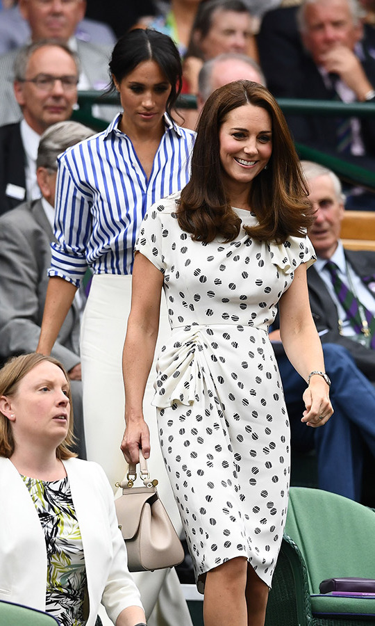 Kate looked picture-perfect in polka dots and a beige handbag.