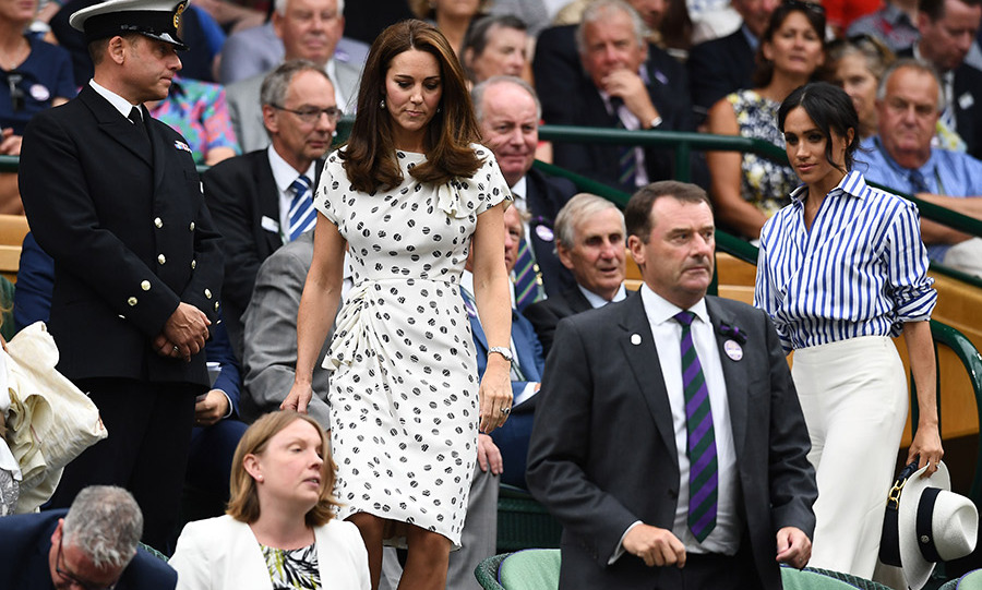 Let the spectator fun begin! The sisters-in-law seamlessly navigated the stands to get to their seats.