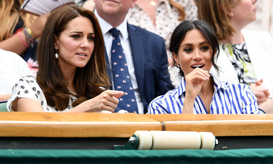 Seasoned Wimbledon supporter Kate pointed something out to Meghan, who looked surprised!