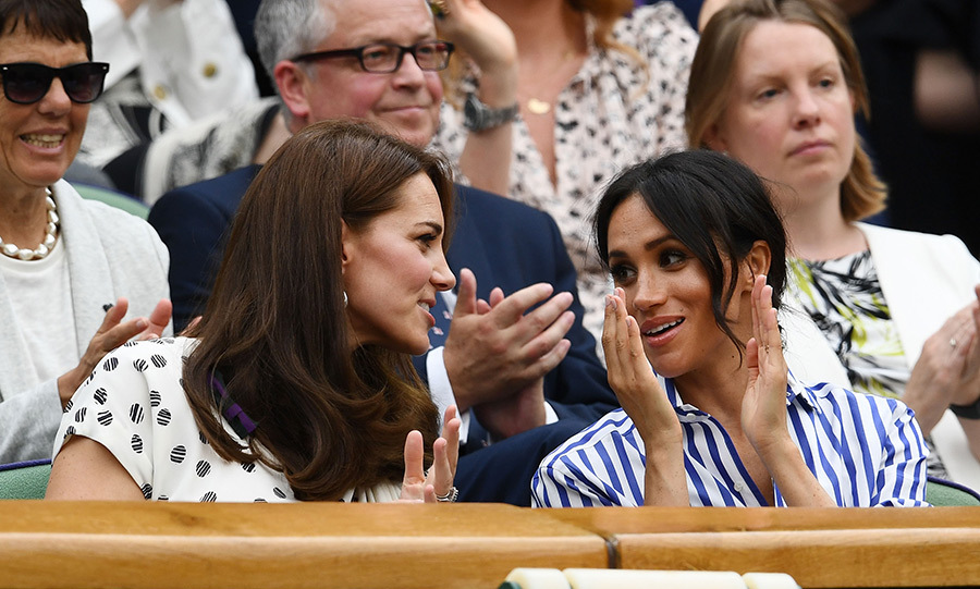 Prince William and Harry's wives got close as they chatted and clapped during the match. 