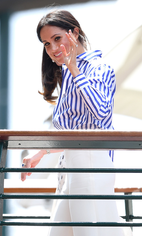 Meghan waved to fans as she arrived with Duchess Kate for a day of tennis fun!