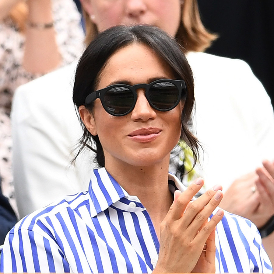Meghan slipped on a pair of black shades.