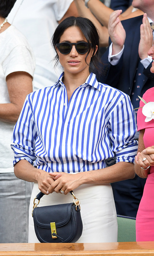 Meghan carried a little black bag by Altuzarra. 