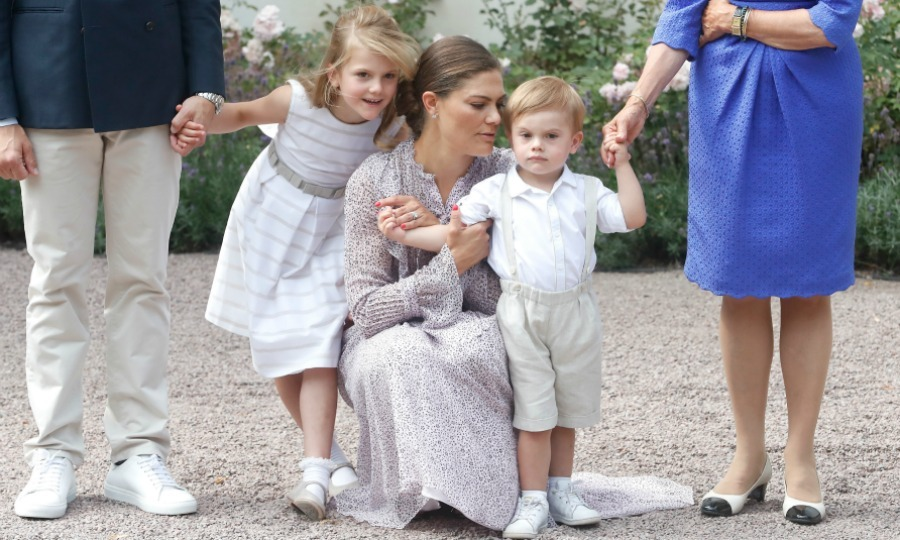 The future queen and doting mom snuggled up to her kiddies during the event, which also saw her make a speech and mingle with admirers. Victoria was dressed in a floral-print, long-sleeved midi dress while her children wore white and beige ensembles. 