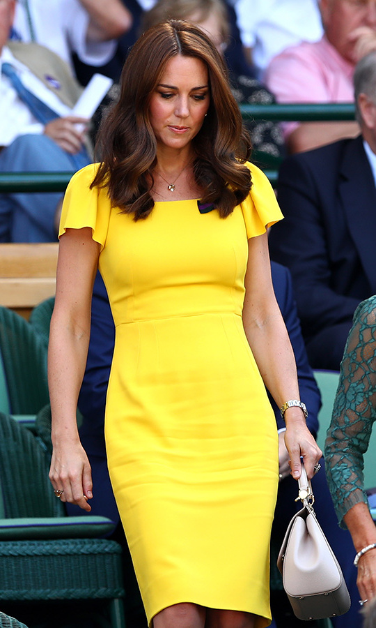 Kate was a ray of sunshine in a fitted yellow Dolce & Gabbana dress with fluttery sleeves and a beige handbag. She wore her hair in soft waves along with her usual natural makeup highlighting her pretty features. 