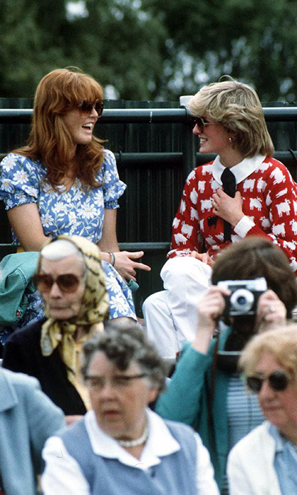 The Duchess of York and the Princess of Wales had a ball in the stands at the Guard's Polo Club in Windsor in June of 1983. Fergie wore a blue floral-printed dress with oversized sunnies while Diana stayed snug with a sheep-printed sweater from the London shop Warm And Wonderful. <p>Photo ©  Jayne Fincher/Princess Diana Archive/Getty Images