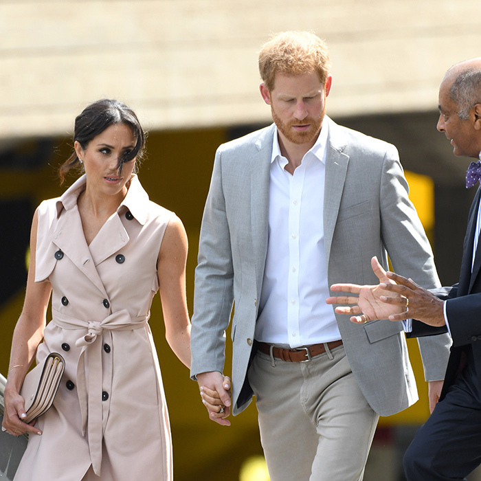 While arriving at the exhibit, the Duke and Duchess of Sussex were spotted holding hands.