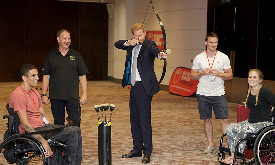 The royal tried his hand at archery while meeting with Liam O'Keefe and Dani Watts.