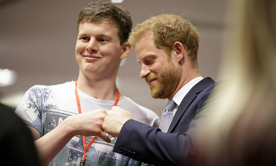 Pound it! Prince Harry took some time on July 18 to meet with Injured Players Foundation member Sam Harrison during a visit to the RFU Injured Players Foundation annual Client Forum at Twickenham Stadium.