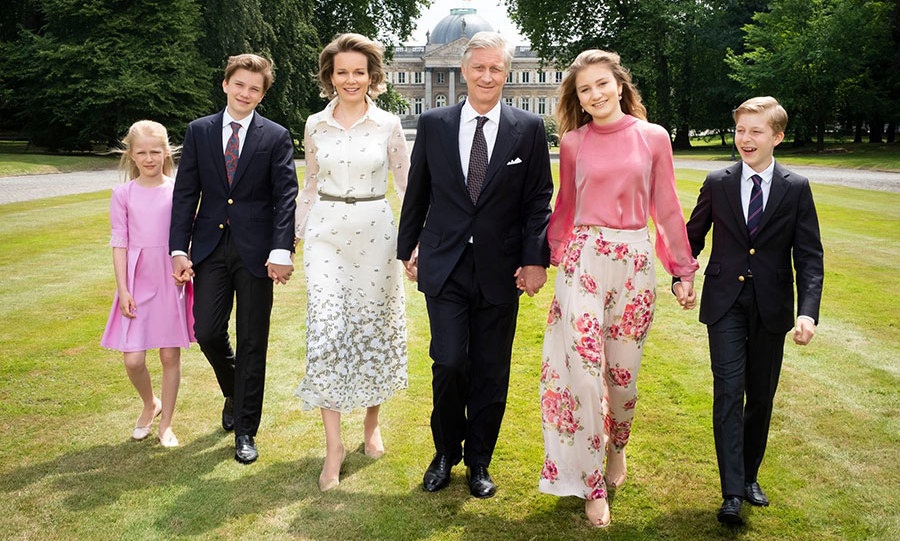 Belgium's royal family went glam for a photoshoot celebrating the fifth anniversary of King Philippe ascending the throne. The 58-year-old strutted the palace grounds alongside his wife Queen Mathilde, 45, and their four gorgeous children - Princess Eléonore, 10, Prince Gabriel, 14, first-in-line to the throne Princess Elisabeth, 16, and 12-year-old Prince Emmanuel. The men looked dapper in suits while the women donned their best summer-chic ensembles! 