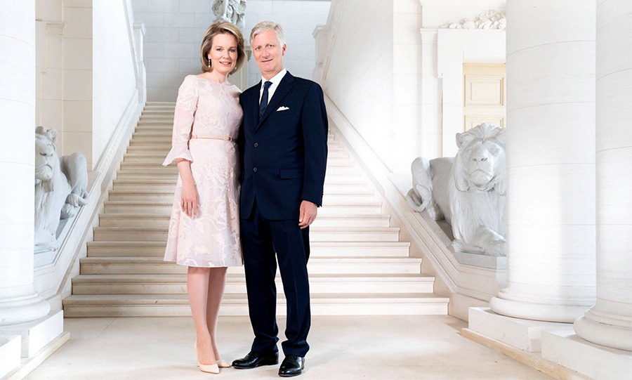 Picture perfect! Queen Mathilde looks gorgeous in the third photo, wearing a soft pink dress with a fluttery sleeve and a thin belt a la Meghan Markle. She stands close to her husband, King Philippe, who looks handsome in his navy suit. The happy couple, who met while playing tennis, will celebrate their 20th wedding anniversary next year.