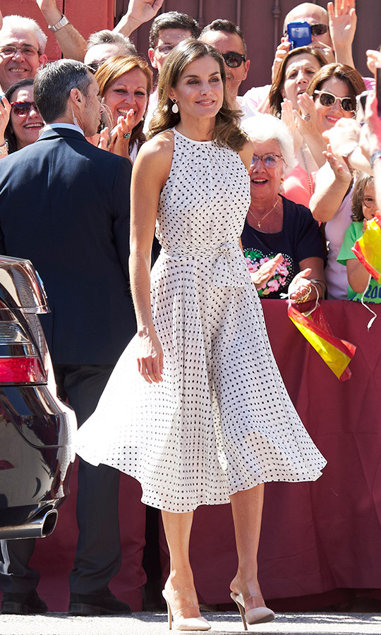 The queen of recycling  slipped on one of her go-to frocks for an outing in Bailen, Spain on July 19. She accented the polka-dot Carolina Herrera halter dress with perfectly coordinated black-and-white earrings and her favourite affordable Steve Madden mules with a PVC strip across the top of the foot.