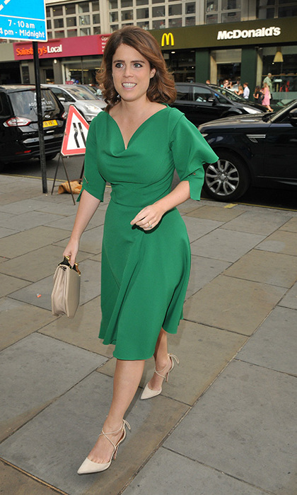 While stepping out to attend the Nelson Mandela Centenary Celebration at Coutts Bank in London, soon-to-be royal bride Princess Eugenie slipped into a silk green dress with embellished sleeves, her go-to M2Malletier bag and a pair of cream, lace-up Aquazzura heels – the same ones the Duchess of Sussex wore for her official engagement photo call in November 2017!