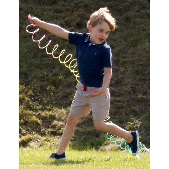 The prince was spotted playing with a slinky while out at a polo match with his family.