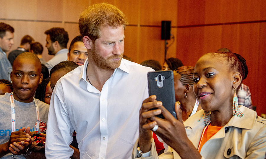 Harry snapped a selfie with a delegate.