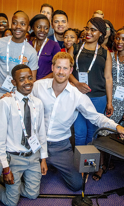 The royal posed with delegates before the 22nd annual conference.