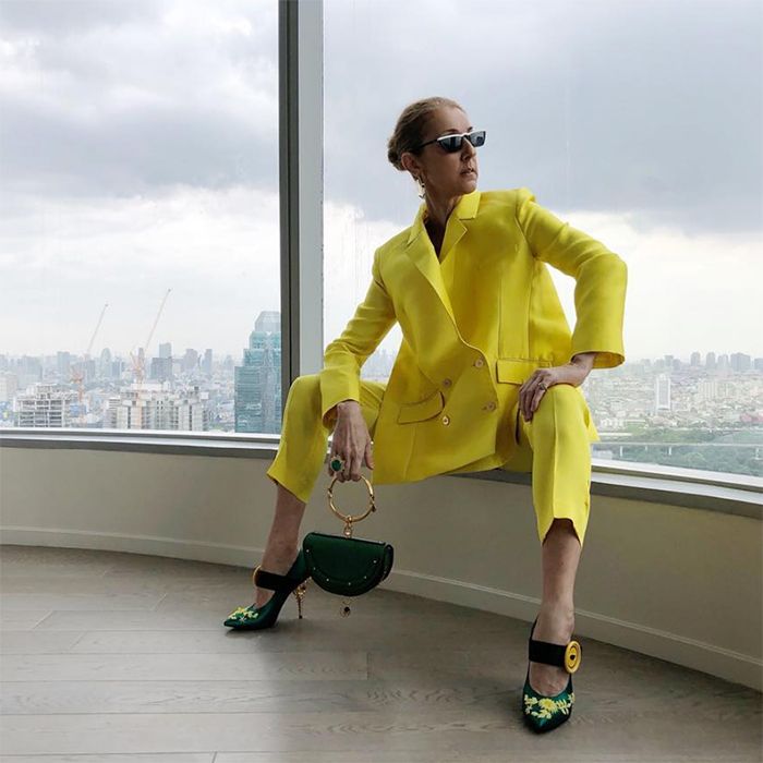 Celine brought out her sunny fashion savvy for an evening in Bangkok. Wearing head-to-toe designer, the singer donned a highlighter yellow suit by Maison Rabih Kayrouz, accessorizing with a Celine bag, Prada heels and sunglasses and Jennifer Fisher earrings.