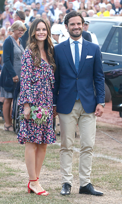 Princess Sofia looked ready for summer in a pretty floral dress and statement red sandals. She and her husband, Prince Carl Philip, were attending Crown Princess Victoria of Sweden's 41st birthday celebrations at Borgholm Sports Arena on July 14.