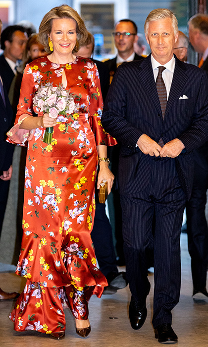 King Philip and Queen Mathilde arrived to the Prelude to the National Day Concert at Palais des Beaux-Arts on July 20. The royal woman stunned in a satin floral floor-length gown.