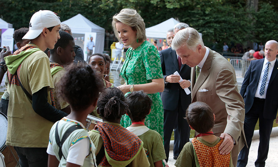King Philippe and Queen Mathilde visited with youth during the Parc visit on National Day.