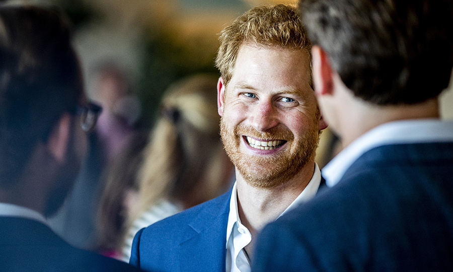 Prince Harry showed off his megawatt smile while meeting with entrepreneur, inventor and CEO of The Ocean Clean up, Boyan Slat, at a reception hosted by the British ambassador at the Pakhuis de Zwijger.