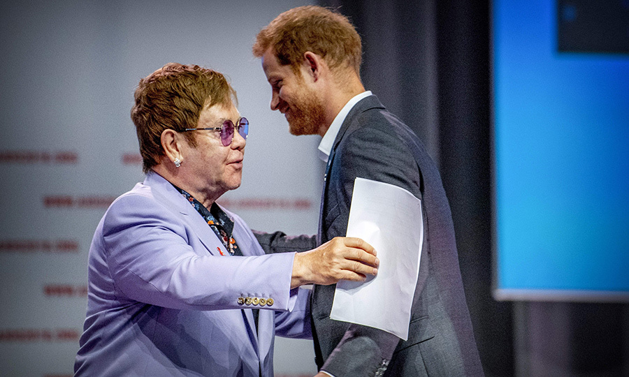 Sir Elton John went in for a hug as Harry walked on stage.